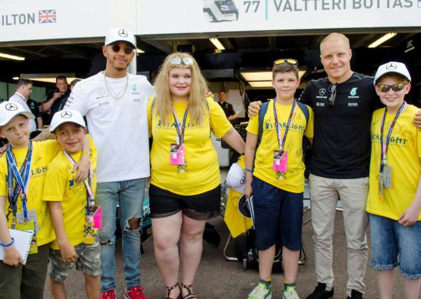 Jack Laine-Turner right with Lewis Hamilton and others who were present on the trip.