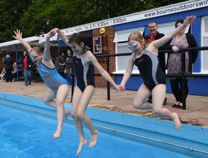 Opening of the Bourne open air swimming pool - somke of the first youngsters in the water EMN-150524-175220009