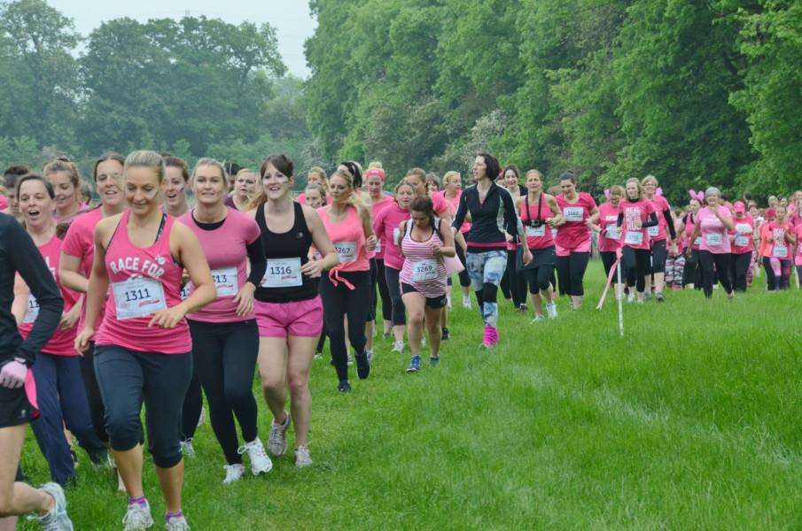 Runners in the Race for Life Pretty Muddy event at Burghley Park. EMN-160406-203907009