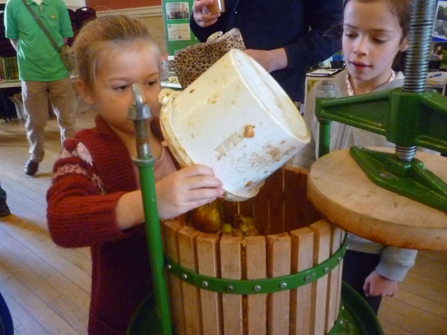 Youngsters try their hand at making apple juice during last year's Apple Day