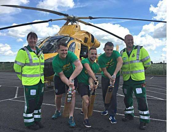 Billingborough cricketers aim to raise �20,000 for Lincs and Notts air ambulance while breaking a world record. Pictured from left are Jane Pattison - paramedic, Shaun Brown, Richard Wells, Dave Newman and Neil Clarke, paramedic and ops manager.
