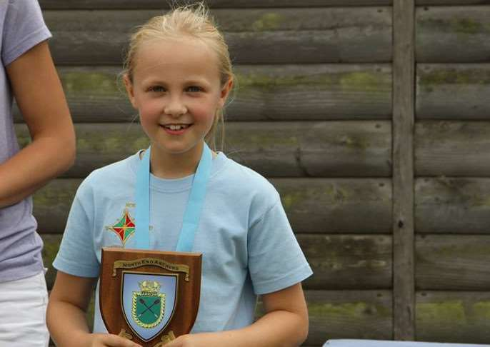 UPWARDLY MOBILE: Donington archer Matilda Craven collects one of her many trophies and medals.