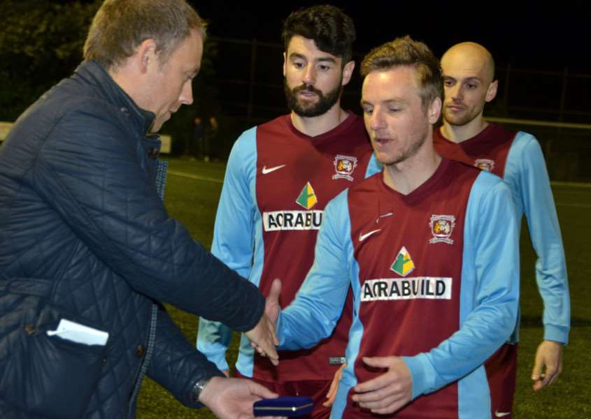 Top scorer Scott Coupland collects his medal on Tuesday night