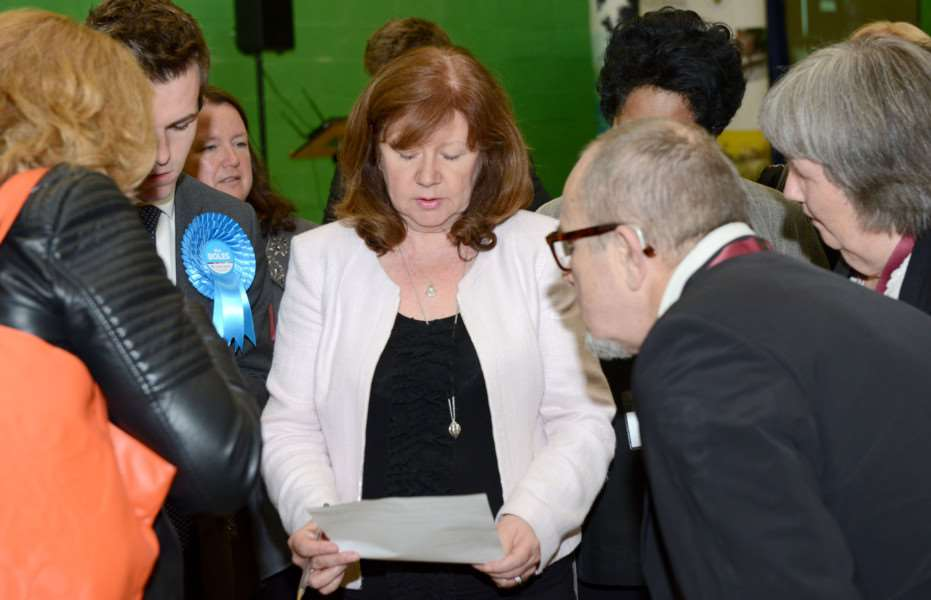 Returning officer Beverly Agass goes through the result before making the announcement.
