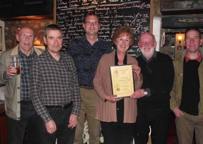 The Melton CAMRA judging team (Melton CAMRA Pub of the Year stage) and the winning landlords. Pictured from left are Harvey Hopwood, Nigel Wood, Kevin Billson, Carol and Jeff Evans and Geoff Helstrip EMN-150906-135837001