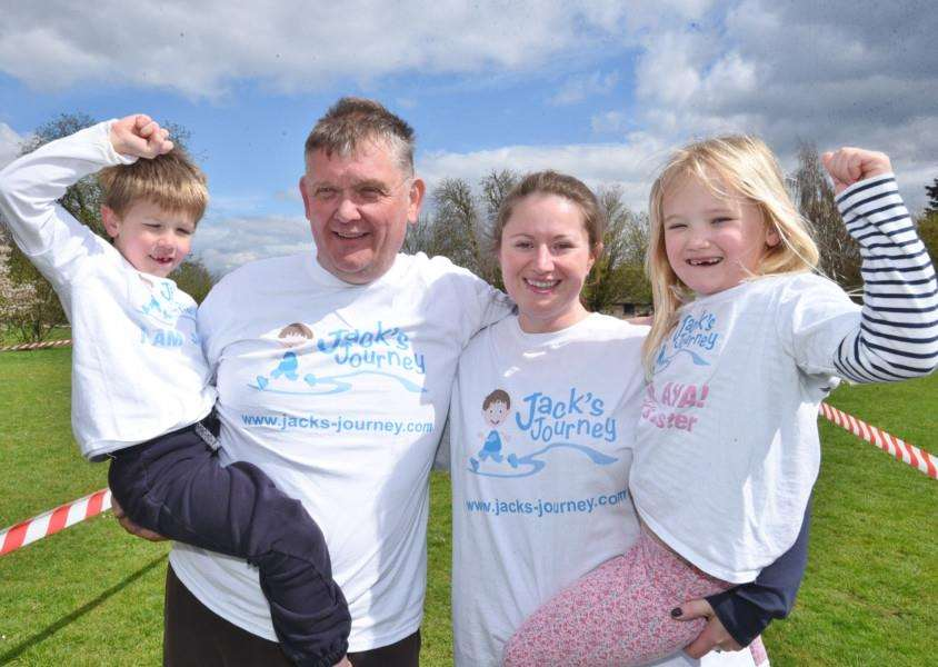Jack Rickard with family Steve and Shona Rickard and six-year-old sister Ava taking part in the Barnack Fun Run EMN-160416-173305009