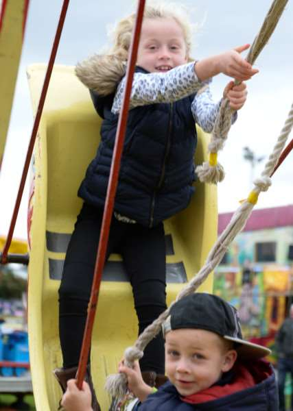 Cottesmore Fun Day. Aimee and Ollie Martin take to the swings'Photo: Alan Walters EMN-151019-151814001