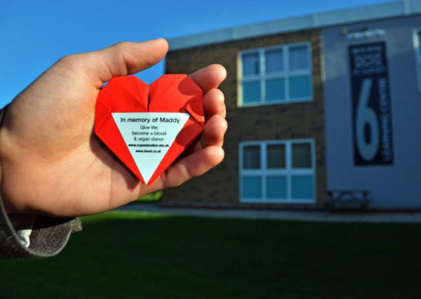 A heart-shaped information badge given out at Bourne Academy in support of Cardiomyopathy UK as a tribute to former sixth-former Maddy Orford. Photo: SG081217-105TW.