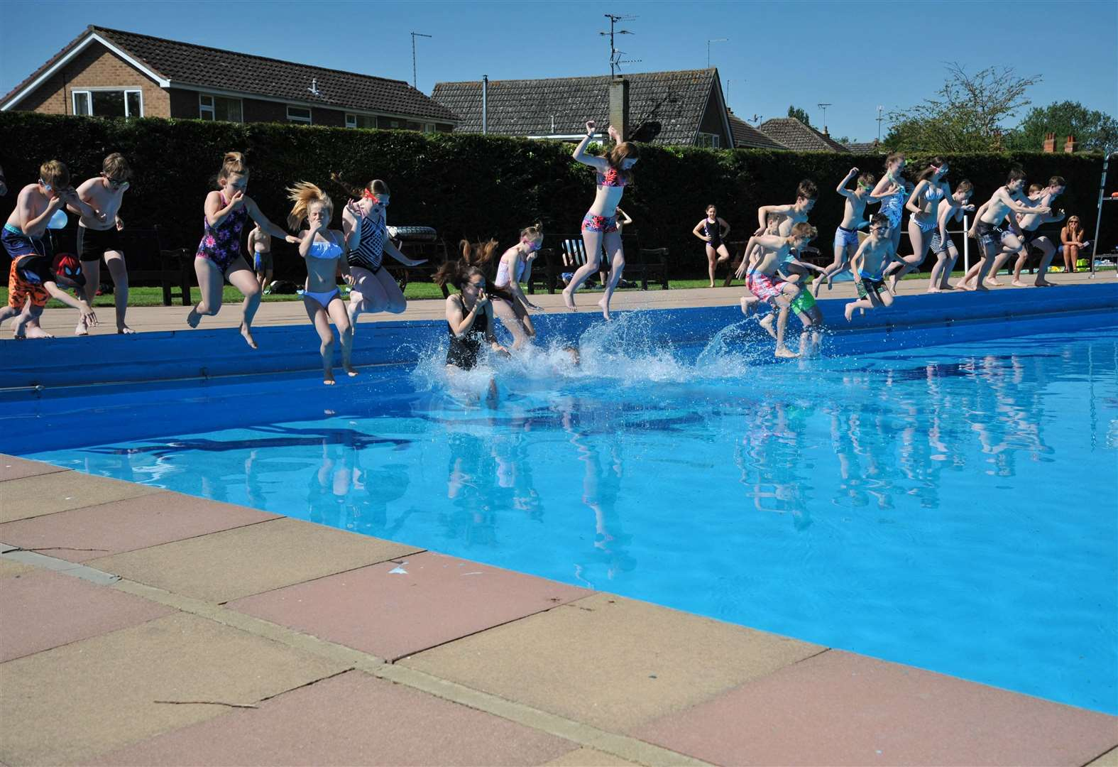 Outdoor pool opens for 100th season