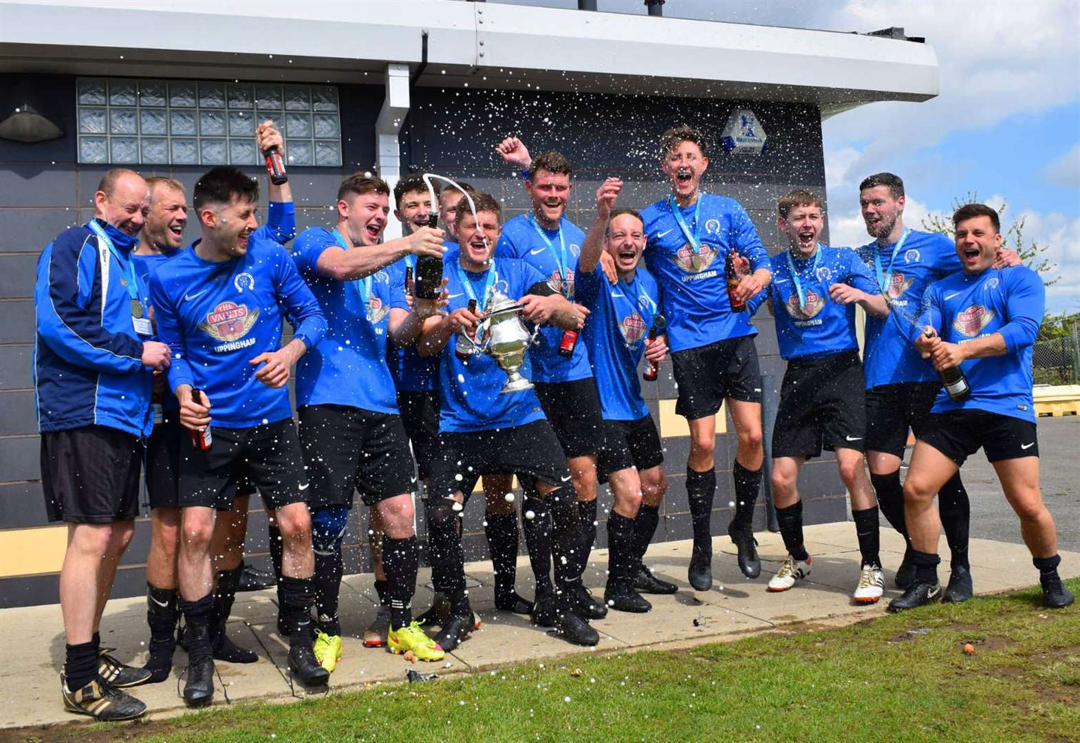FOOTBALL: Terrific Town toast tremendous campaign by completing cup double