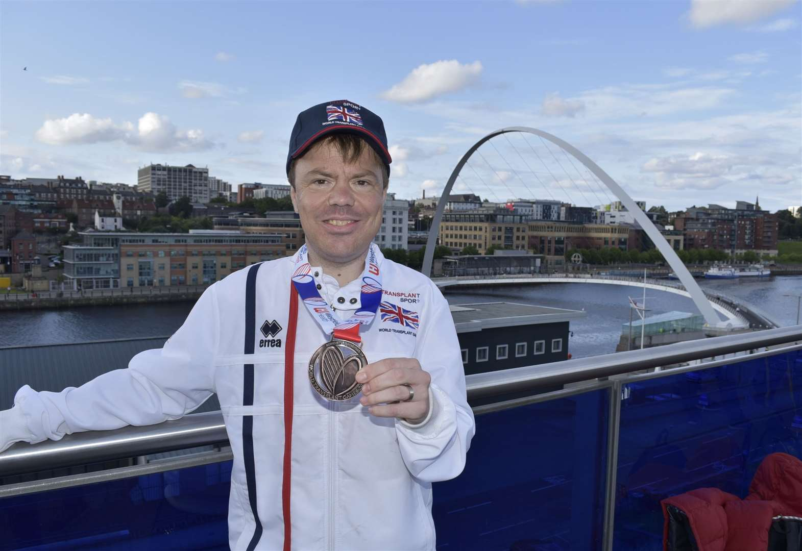 Man wins medal in transplant games just six months after receiving his mum's kidney