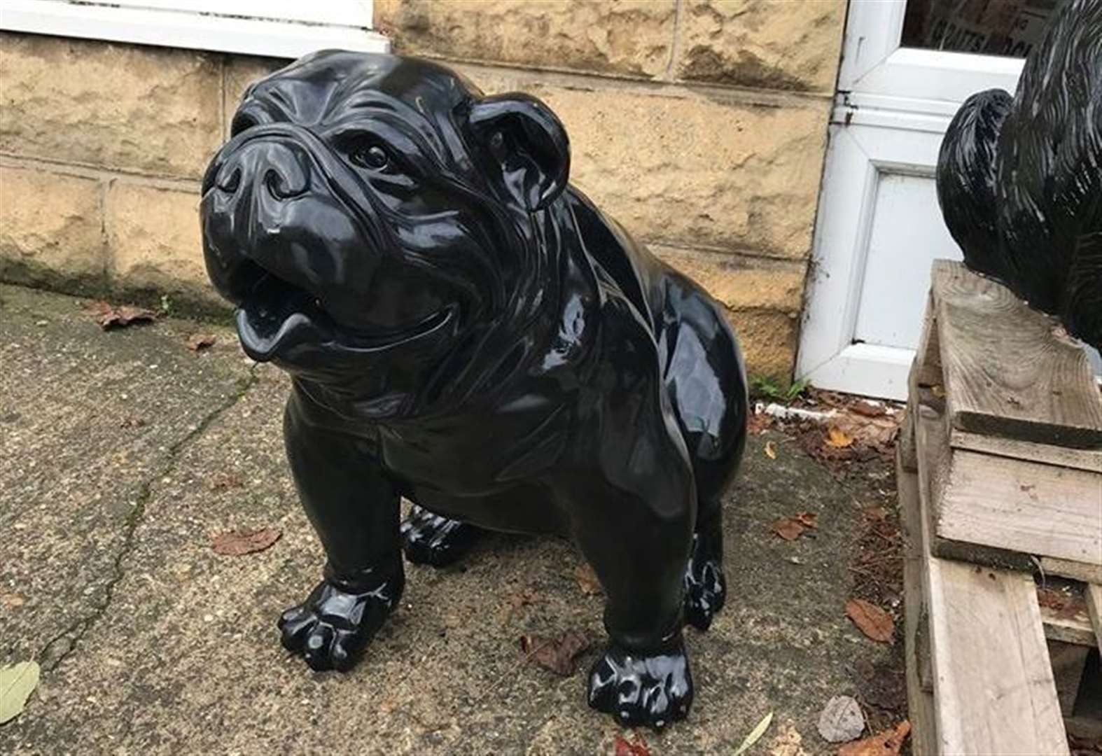 Black bulldog sculpture is stolen from outside shop