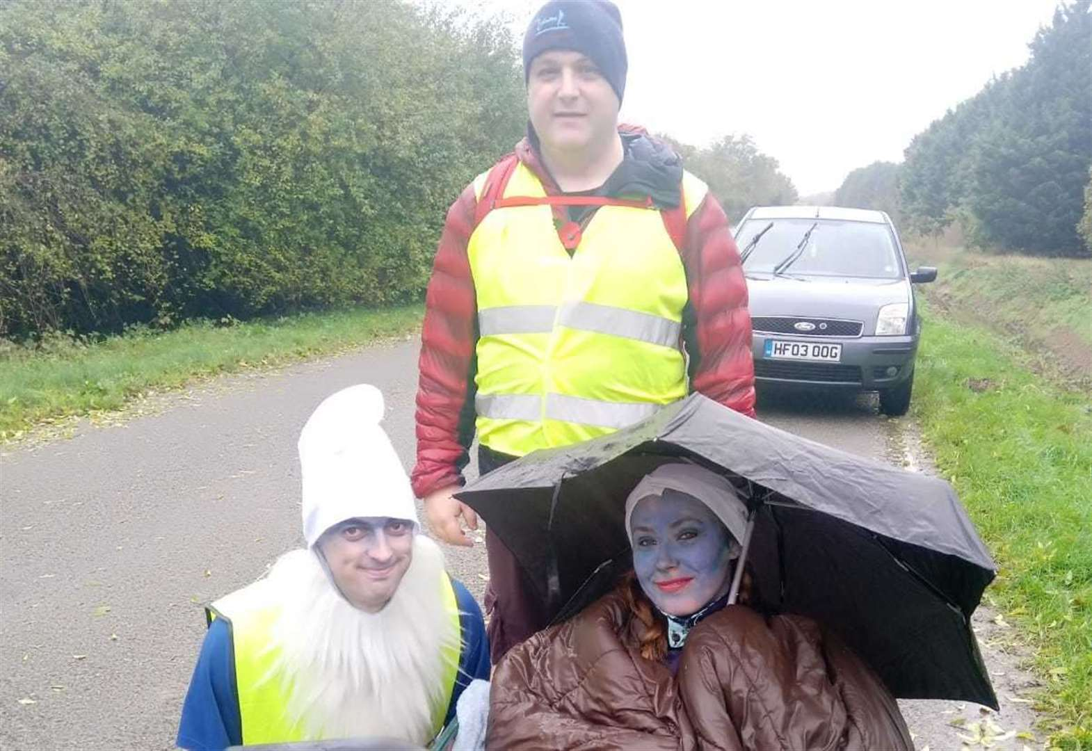 Charity smurfs battle the wind and rain