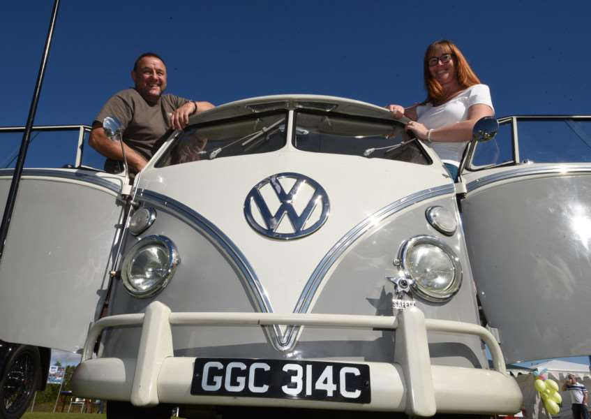 Ketton village fete. Nigel Powell and Tina Powell showing their VW camper van. EMN-150927-170401009