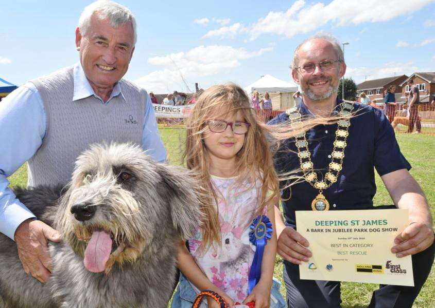 Bert Murray with best rescue dog Misty, owner Florence Hobbs, 6, and parish council chairman Steve Gilbert