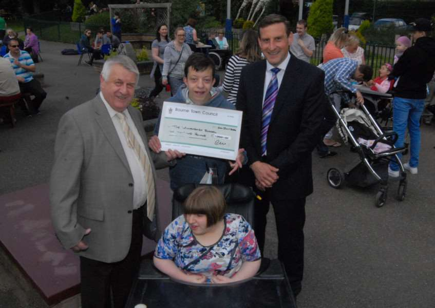 Former Bourne mayor Philip Knowles presents Willoughby School headteacher James Husbands with a cheque for �1,000 from his Mayor's Charity Fund. With them are head boy William Baker and head girl Katie Eliker