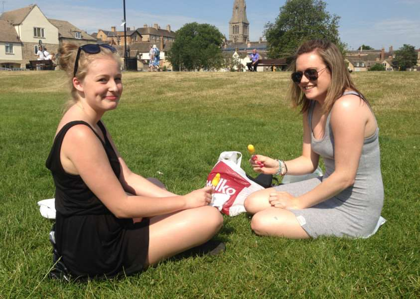Anabelle Spain and Natalie Owen, both 17, enjoy an ice cream on the Meadows in Stamford on the hottest day of 2015 so far. Photo: MSMP-01-07-15-am003. EMN-150207-094552001