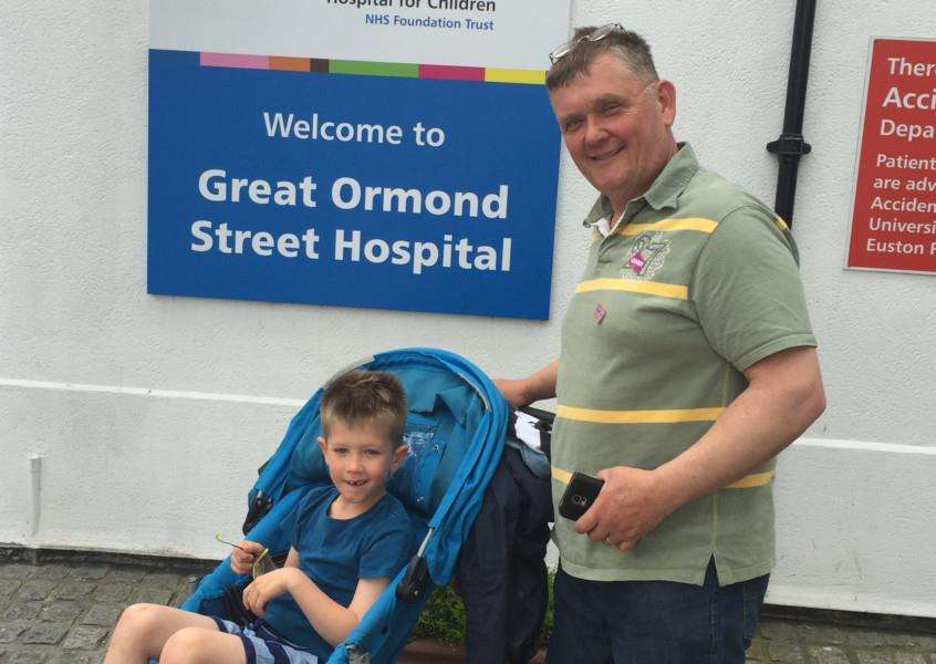 Jack Rickard, 7, and dad Steve pictured at Great Ormond Street Hospital in London. EMN-161107-170125001