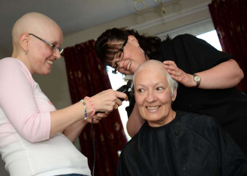 Jan Harvey has her head shaved. She is pictured with her friend Amanda Bills. Photo: Alan Walters EMN-150513-095640001