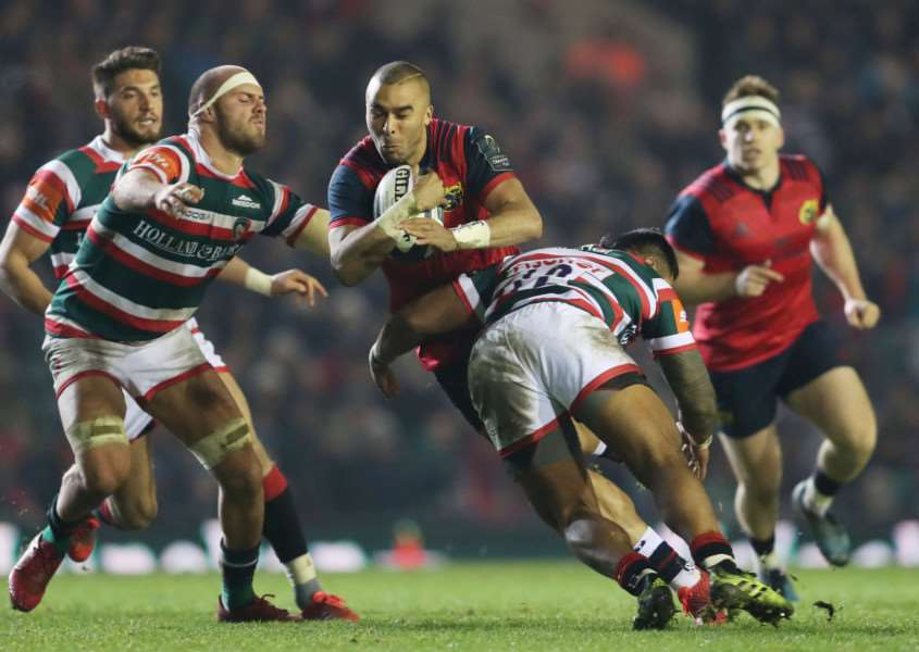 Munster's Simon Zebo is tackled by Leicester Tigers Lachlan McCaffrey and Manu Tuilagi during the European Champions Cup, pool one match at Welford Road, Leicester. Photo: David Davies/PA Wire RUGBYU_Leicester_163873.JPG