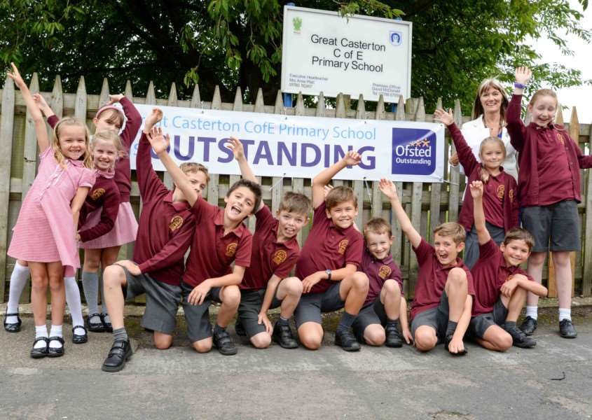 Great Casterton Primary School pupils and headteacher Anne Platt celebrate an 'outstanding' Ofsted report EMN-160609-102957001