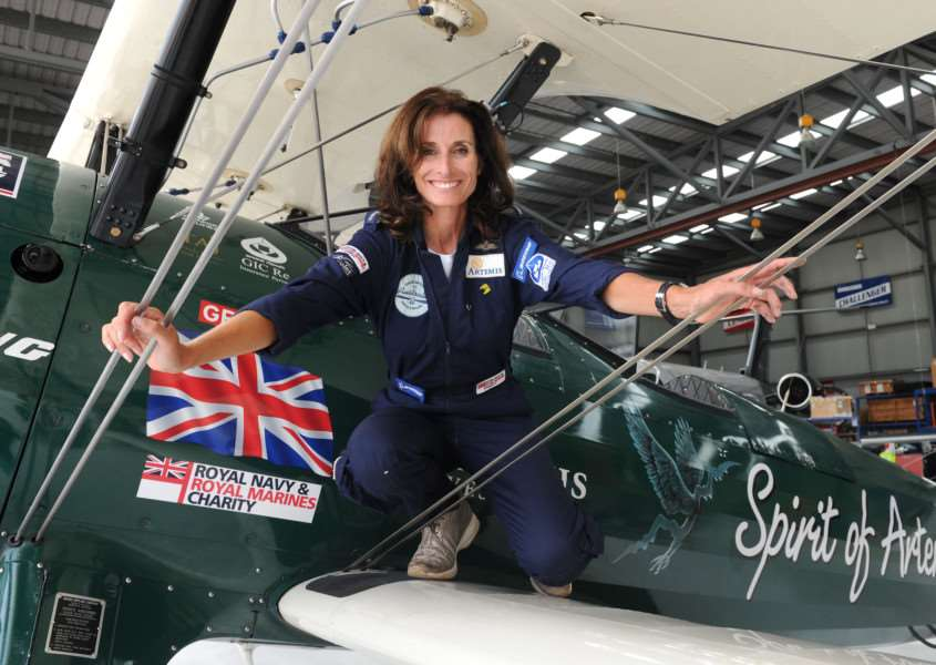 Handout photo issued by Boeing of Tracey Curtis-Taylor at Sydney International Airport, Australia, after flying 13,000 miles in her restored 1942 Boeing Stearman Spirit of Artemis. PRESS ASSOCIATION Photo. Picture date: Saturday January 9, 2016. The British flyer has flown across 23 countries, making 50 refuelling stops over the course of three months, and has now arrived at Sydney Airport. See PA story ADVENTURE Biplane. Photo credit should read: Simon Bullard/PA Wire''NOTE TO EDITORS: This handout photo may only be used in for editorial reporting purposes for the contemporaneous illustration of events, things or the people in the image or facts mentioned in the caption. Reuse of the picture may require further permission from the copyright holder. EMN-161201-143357001