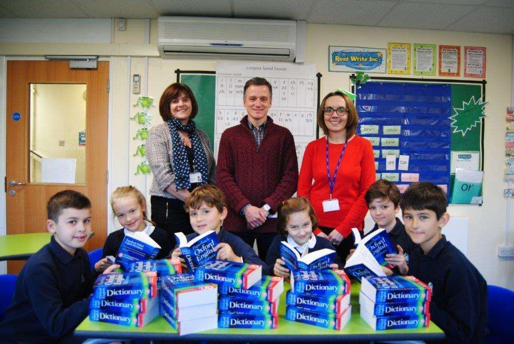 St Gilberts pupils receive dictionaries from the Round Table