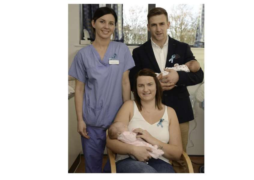 Nathan and Steffanie Curtis with Millie and Charlotte and Neonatal Intensive Care Nursery Nurse ' Magdalena Keminska