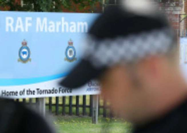Armed police at RAF Marham today. Photo: PA