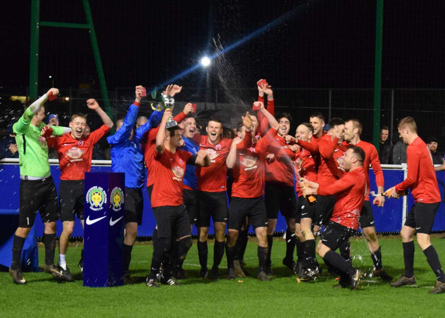 Uppingham Town celebrate their Leicestershire Intermediate Cup triumph. Photo: Melanie O'Berg (7596085)