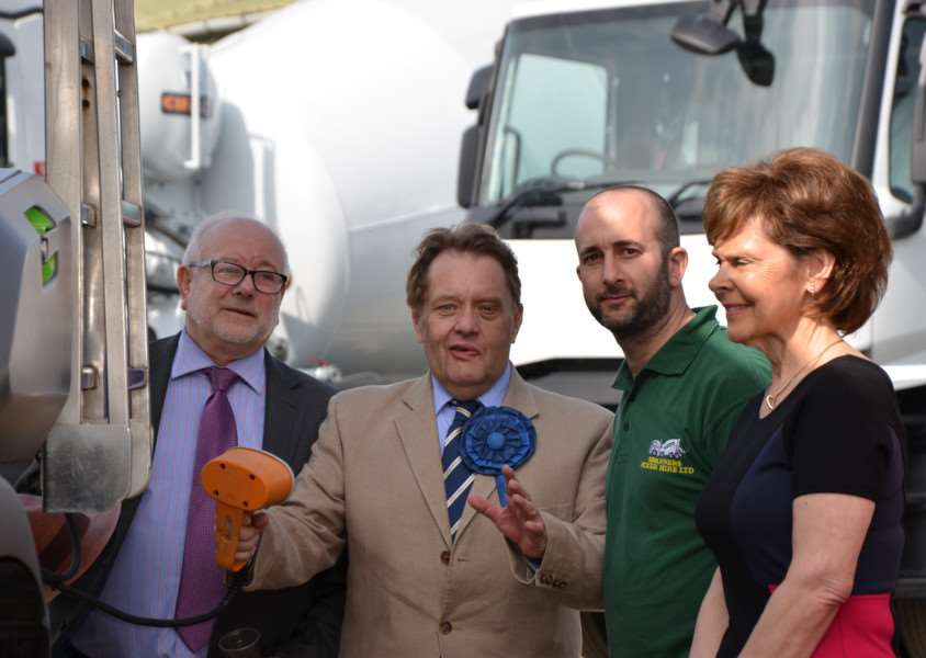 John Hayes (second right) with Peter, Gavin and Lynne Spooncer next to what is believed to be the first plug-in hybrid truck mixer to be imported into the UK by Spanners Mixer Hire in Market Deeping. Photo by Tom Clare Photography.