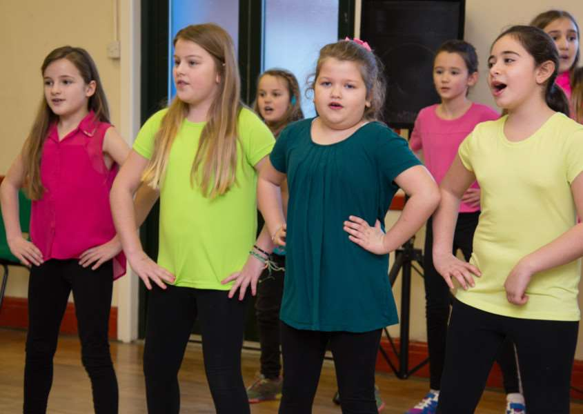 Curtain Upp Stage School members perform