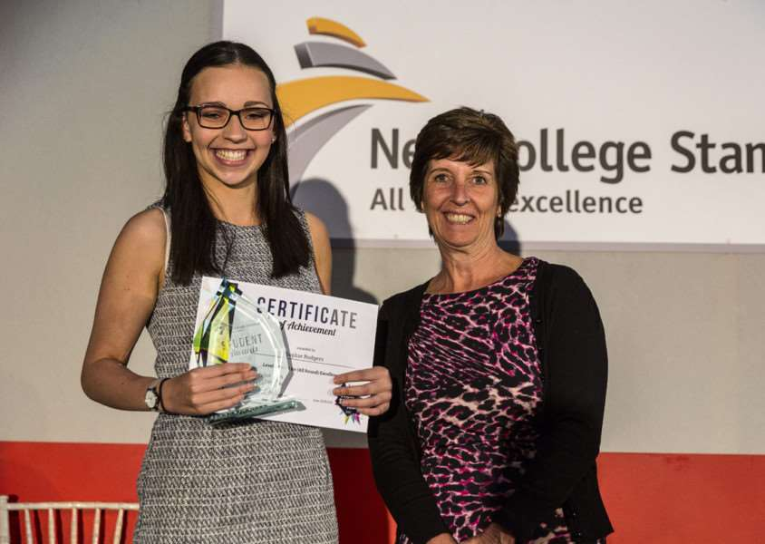 Sophie Rodgers accepts her Award for Excellence from Alison Fox, New College Stamford's assistant principal and executive director of partnerships and skills.