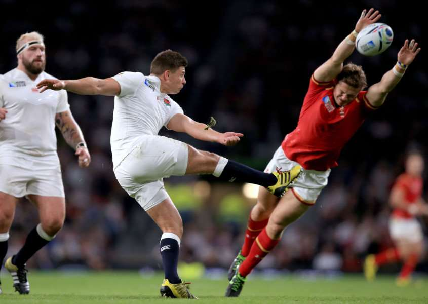 England's Ben Young's (left) is closed down by Wales' Scott Williams during the Rugby World Cup match at Twickenham Stadium, London. PRESS ASSOCIATION Photo. Picture date: Saturday September 26, 2015. Photo: Mike Egerton/PA Wire. EMN-150928-152715001