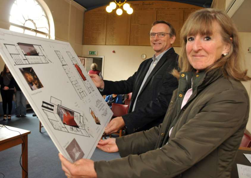 Charles Housego, of the Bourne Town Hall Trust Steering Group, and Coun Sue Woolley, Lincolnshire County Council member for Bourne Abbey look at the plans for modernising and reopening the hall in North Street, Bourne. Photo by Tim Wilson.