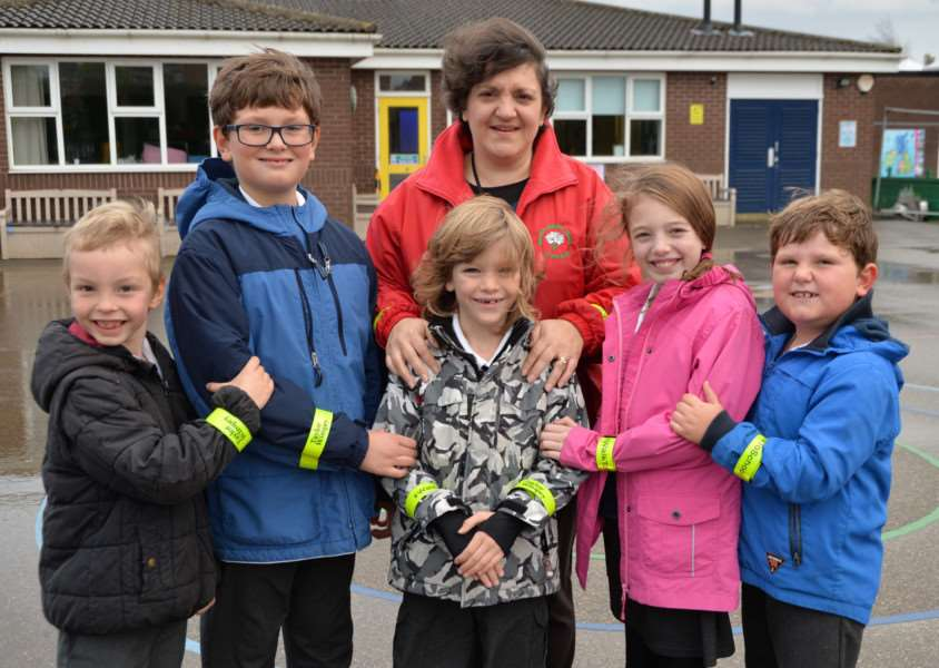 Malcolm Sargent Primary School teaching assistant, Jo Seager with pupils from the school sporting their brand new high-visibility slap bands EMN-150312-112330001