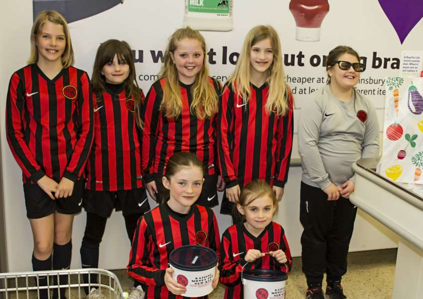 Members of Royce Rangers girls teams, who have been raising funds for new kits at Tesco in Oakham. EMN-150316-114108001
