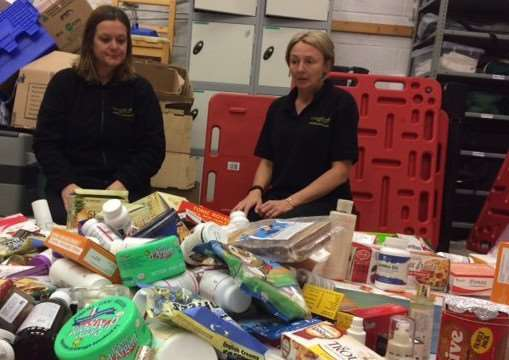Lincolnshire Trading Standards officers Kirsty Toyne and Eve Wrighton with a range of products used by scammers who have cheated victims out of an estimated �2million over the last 18 months. Photo supplied by Lincolnshire County Council.