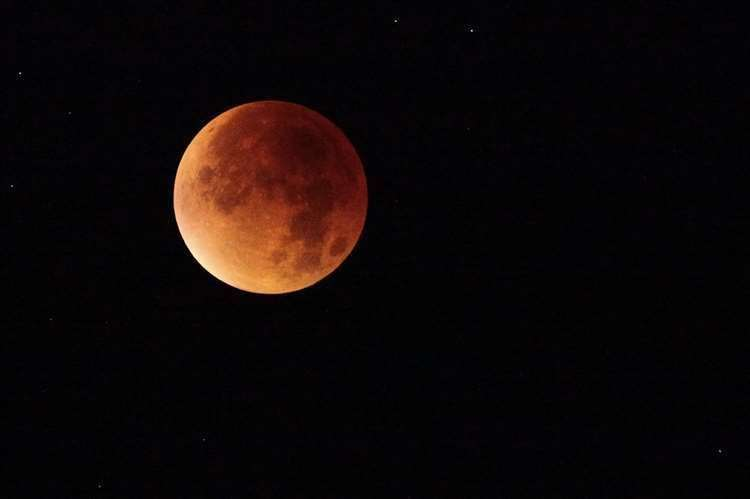 A partial lunar eclipse could make the moon appear red