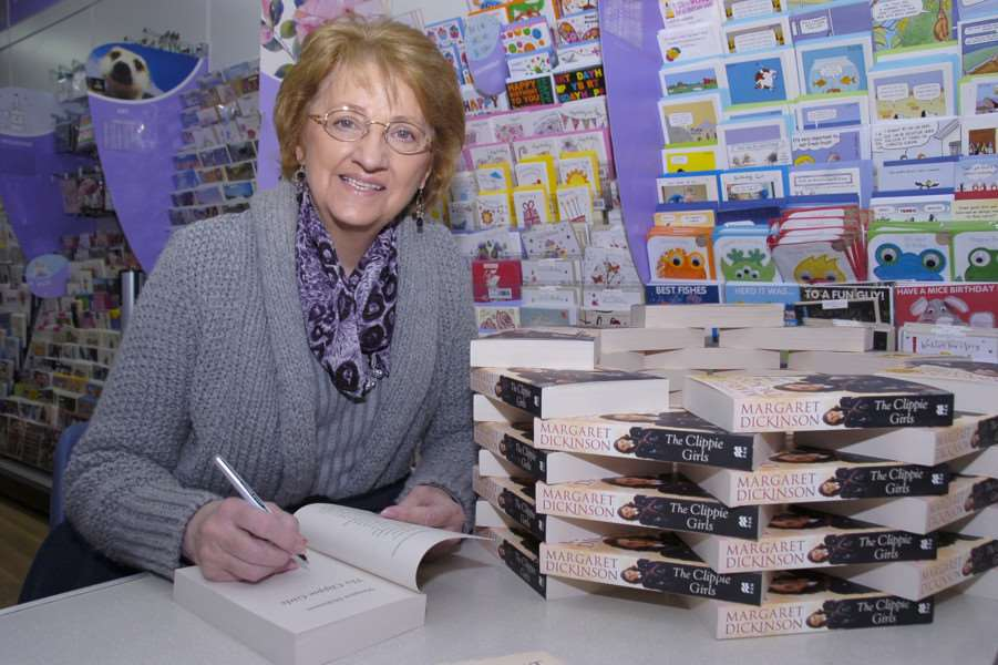 Lincolnshire author Margaret Dickinson signing copies of her book 'The Clippie Girls'.