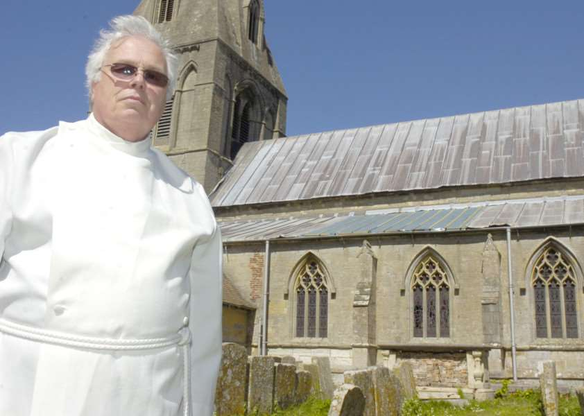 Rev Charles Sowden outside Frampton St Mary's Chruch which has had lead stolen from the roof. ENGEMN00120110205141942