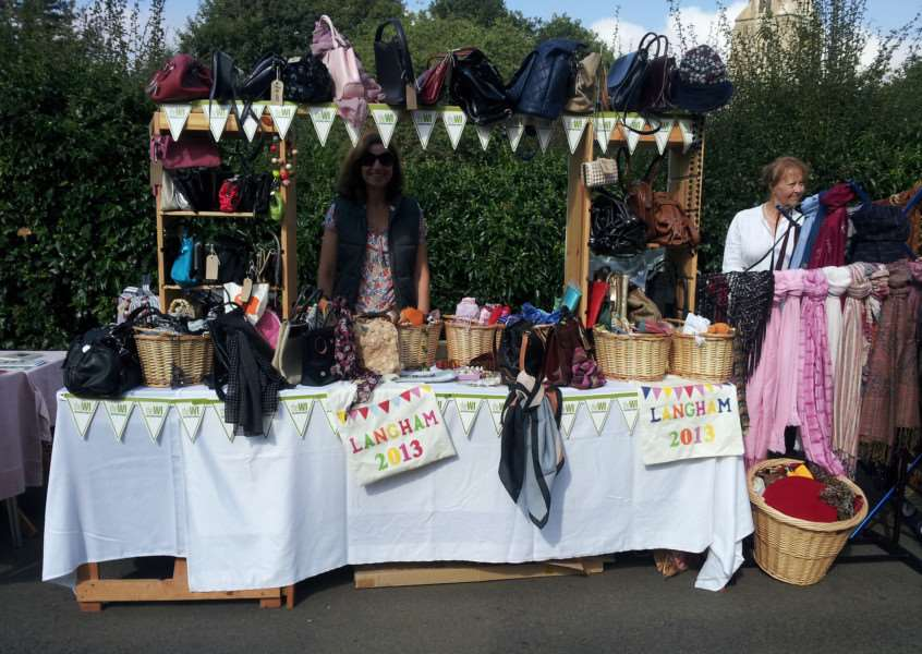Becky Cecco and Karen Allen on the Langham WI bags and scarves stall at Langham Street Market. ENGEMN00120130828100643