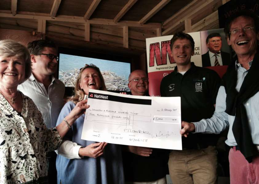 Tricia Lawrence (left) with son Stephen, daughter Susannah and Chairman of Trustees of MLMT James Lawson, presenting the cheque to Tim Mackrill & Paul Stammers from the Rutland Osprey Project. EMN-150413-184223001