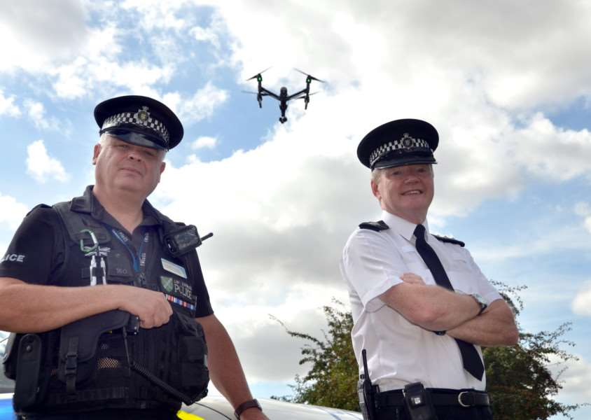 GALILEO STATISTICS: PC Nick Willey, rural and wildlife crime officer, with Chief Inspector Jim Tyner and a drone available to hunt hare coursers across South Holland. Photo by Tim Wilson.