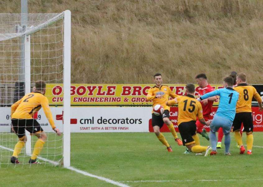 Action from Stamford AFC's 1-0 win in the FA Trophy over Basford United. Photo: Geoff Atton EMN-161110-093128001