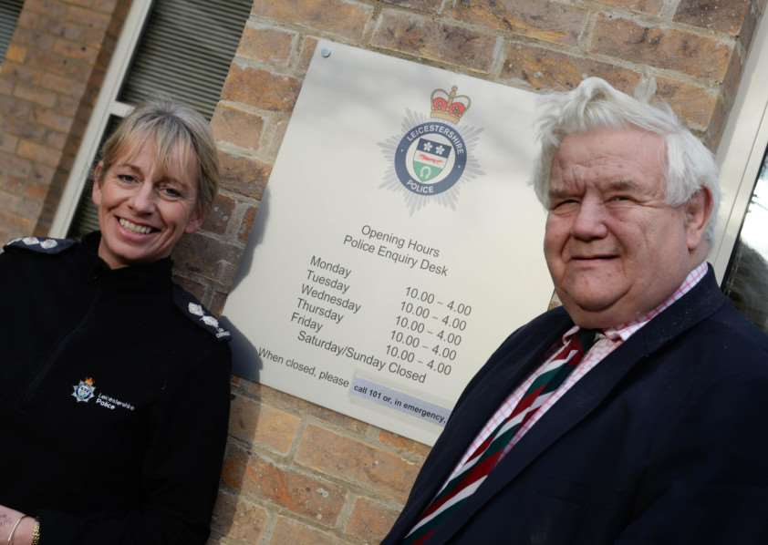 Inspector Lou Cordiner and Rutland County Council leader Roger Begy (Con) open the new police front enquiry desk at Catmose in Oakham. Photo: Alan Walters MSMP-07-01-15-aw001. EMN-150701-105343001