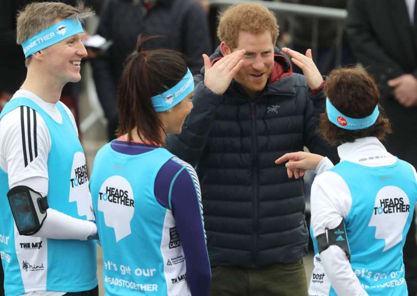 Prince Harry meets runners taking part in the London Marathon for mental health charity Heads Together. Photo by Owen Humphreys/PA Wire.