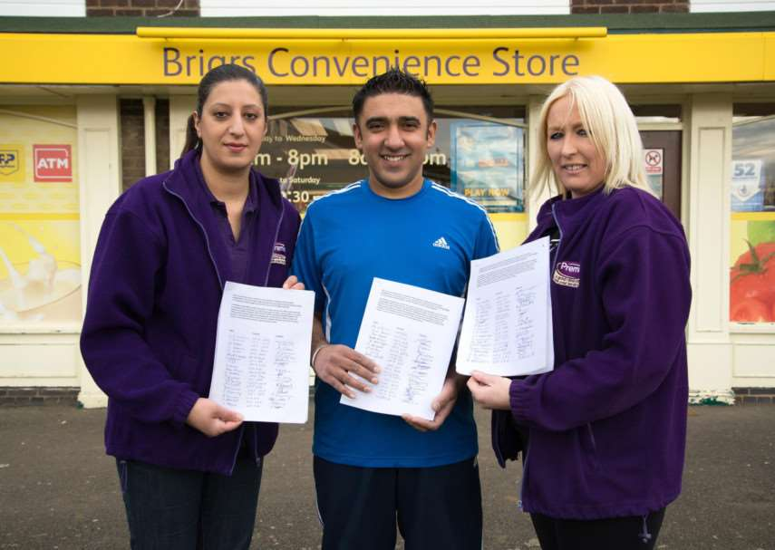 Campaign to get a Post Office counter at Briars Convenience Store in Oakham. Owners Inderjit and Devinder Gill with Ollie Leikh. Photo: Alan Walters MSMP-09-03-15-aw005 EMN-150903-153103001