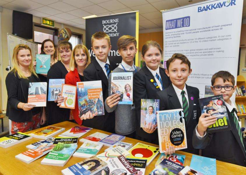 Lisa Hasbury and Rachel Green from Bourne Academy with Nickki Gash and Jennie Beasley from Bakkavor with students in the school library at presentation of career books to the school from Bakkavor EMN-161019-170555009