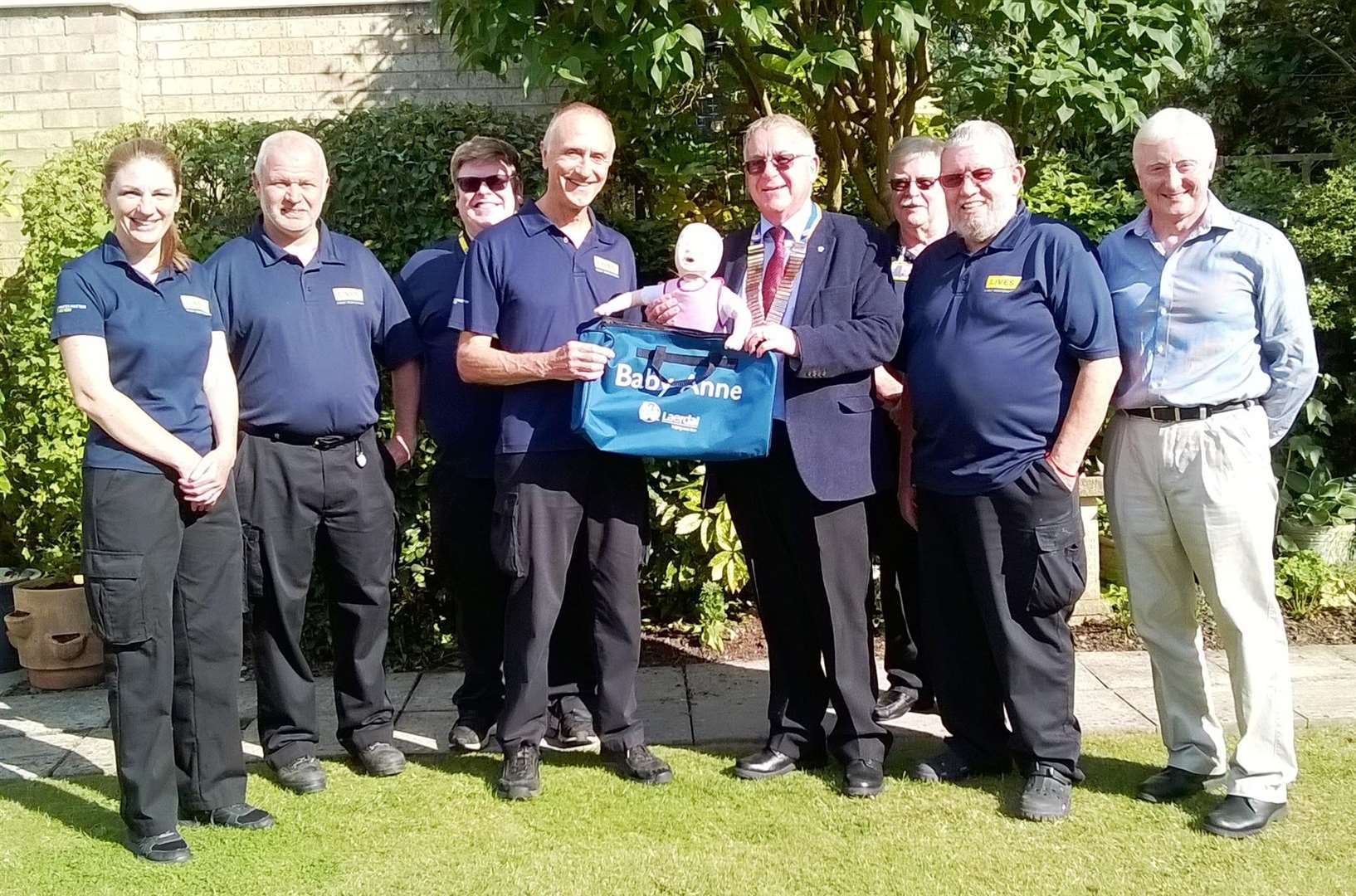 President of the Rotary Club of the Deepings, Alan Kendrick, presents the Baby Anne CPR doll to Russell Handley of Deepings First Responders